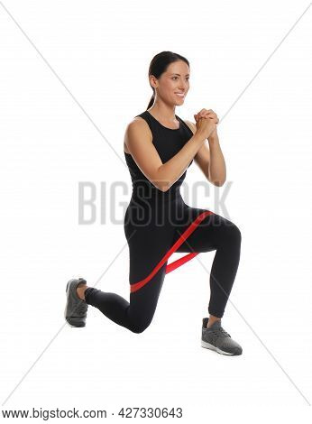 Woman Doing Lunges With Fitness Elastic Band On White Background