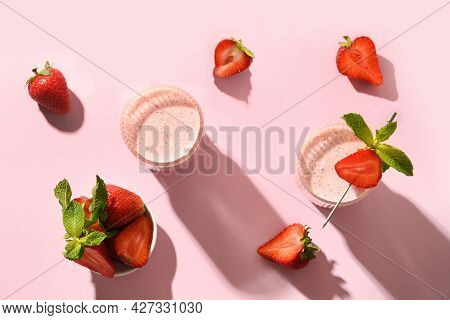 Indian Strawberry Lassi Or Milkshake On Pink Background