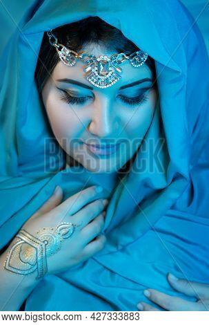 Portrait Of Eastern Woman Closeup With Blue Scarf. Arabian Woman.