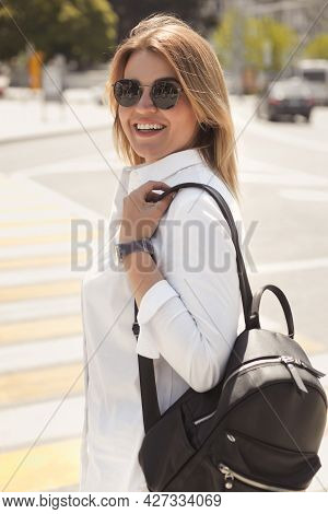 Urban Portrait Of Happy Young Blonde Woman 30-35 Years Old In White Casual Clothes, Sunglasses And A