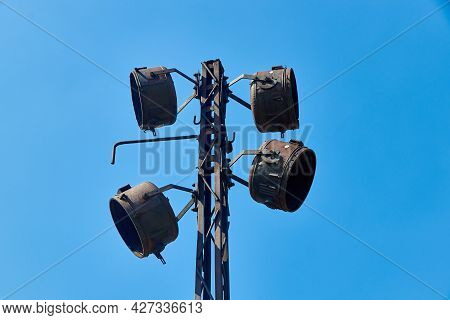 Metal Pole With Old Floodlights Without Lamps And Glass