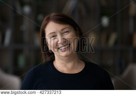 Happy Senior Lady Looking At Camera With Toothy Smile