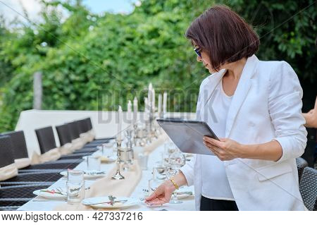 Organization Of Weddings, Parties, Catering For Events. Female On The Background Banquet Decorated T