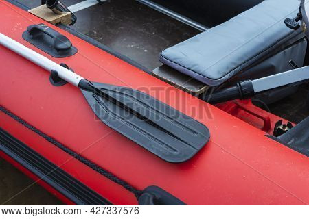 Paddle On Board A Rubber Inflatable Boat, Red Inflatable Boat With A Paddle, Tourism, Active Lifesty