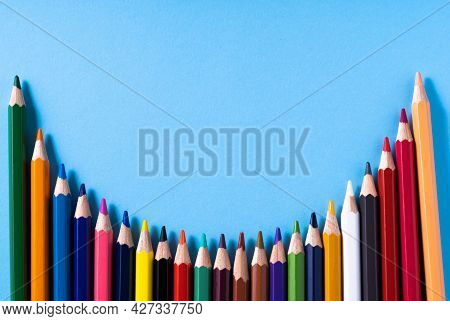 Colorful Pencils And Place For Text On Blue Background. Education Concept And Back To School Concept