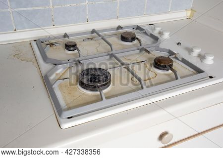 Dirty Gas Stove Cooking Oil Stains On Gas Stove In Kitchen.an Unclean And Dirty Kitchen Used For Coo