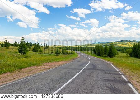 Summer Siberian Landscape With Winding Road Among Green Hills In Khakassia, Russia. Russian Federal