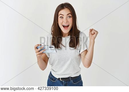 Excited Woman Winning Prize On Phone, Rejoicing And Looking At Camera Happy, Scream Of Joy Over Whit