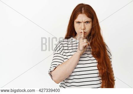 Angry Redhead Teen Girl Hush, Frowning Upset And Shushing, Tell To Be Quiet, Scolding Loud Behaviour
