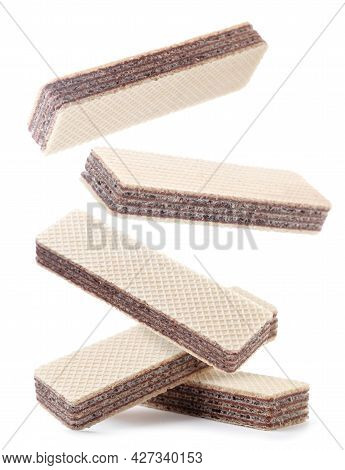 Wafers Fall On A Pile Close-up On A White Background. Isolated