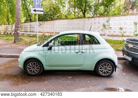 Moscow , Russia - July 2021: Street Shot Of Mint Color Car Fiat 500. Side View Of Small City Car In