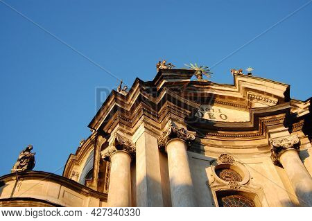 Dominican Church Central Facade At Summer Sunset On Clear Sky. Architecture Of Old Lviv City In Ukra
