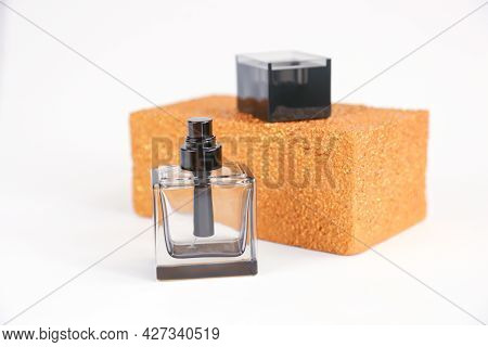 Unbranded Black Square Perfume Bottle And Golden Rectangular Shape Isolated On White Background. Fro