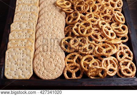 Cclose-up Of Wooden Box With Cookies, Crackers And Mini Salted Pretzels, Party Snacks.