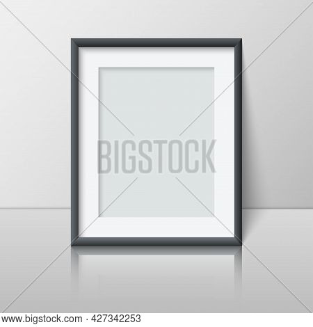 Realistic Vertical Blank Picture Frame Stands Near The Wall On The Shelf. Empty Photo Frame Mockup W