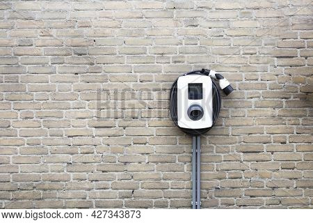 New Charging Station For Electric Car On Brick Wall At Home, Charging Pillar With Copy Space , Space