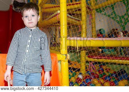 Little Cute Beautiful Boy In The Playroom