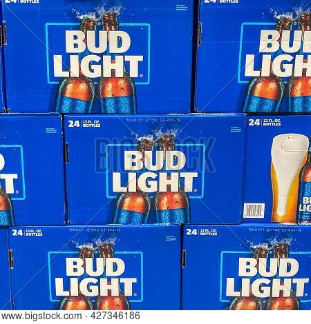 Cases Of Bottless Of Bud Light Beer At A Sams Club  Store Waiting For Customers To Purchase.