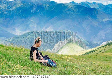 Woman Travels. She Enjoying Nature, Watching Mountain Landscape.