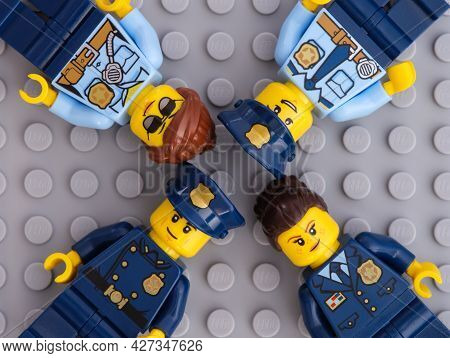 Tambov, Russian Federation - July 05, 2021 Four Lego Police Officers On Gray Baseplate Background.