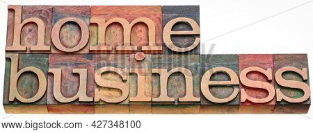 home business - isolated word abstract in letterpress wood type, working from home concept