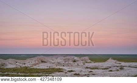 dawn over prairie with rock formations - Pawnee National Grassland in Colorado, early summer scenery