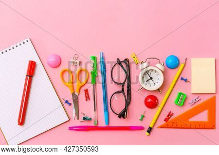 Stationery Colorful Writing Supplies Pens Pencils, Colored Pink Paper As Background. Back To School.