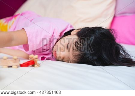 Children Health Care Or Sleep Problems In Young Baby. Kid 4 Year Old Lying On Bed. Sleepy Child Waki