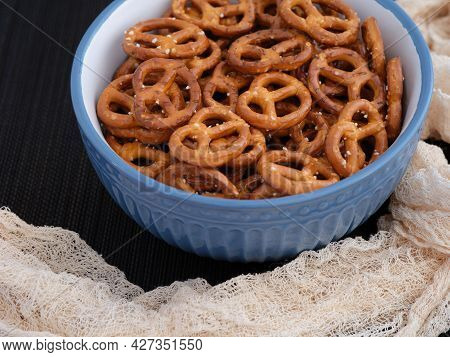 Salted Mini Pretzels In A Bowl. Close Up.