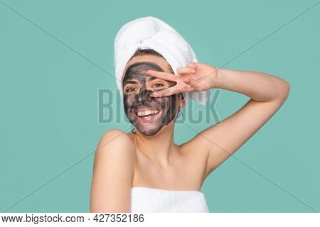Mud Facial Mask, Face Clay Mask Spa. Funny Amazed Woman With Cosmetic Mud Facial Procedure, Spa Heal