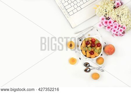 Modern Woman's Work Desk, Home Office, Fruit Salad With Muesli, Grapes, Cherries And Peaches On A Li