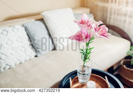 Interior And Home Decor. Fresh Pink Lily Flowers Put In Vase In Living Room By Couch. Bouquet Of Blo