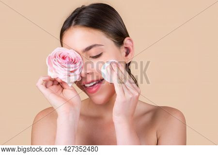Beauty Woman Face With Natural Make Up, Rose Flowers And With Cotton Pads, Sponge, Cotton Ball. Beau