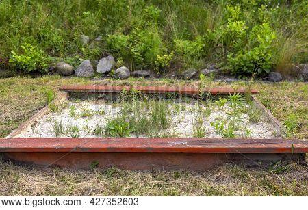 Overgrown With Weeds, Broken Old Red Sandbox For Children, Playground,