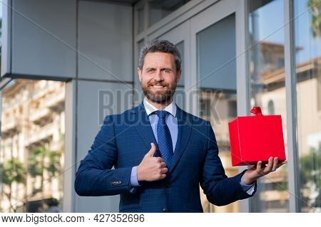 Businessman Outdoor With Shopping Bag. Handsome Man With Birthday Present. Thumbs Up. Anniversary Ce