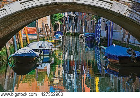 Venice, Italy - May 09, 2013. Buildings, Bridge And Boats In Front Of A Canal In A Sunny Day. At The