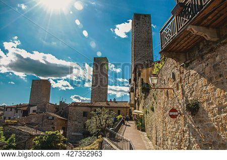 San Gimignano, Italy - May 13, 2013. Street And Towers In A Sunny Day At San Gimignano. An Amazing M