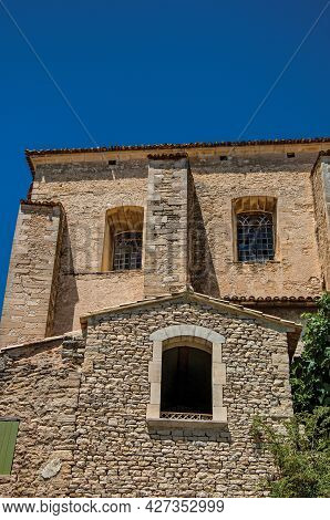 Facade Of Stone House Looking Like A Face, In An Alley Of The Historical City Center Of Gordes. Prov