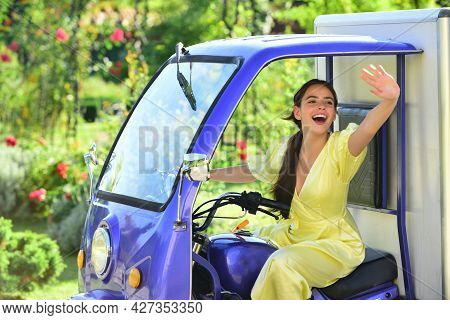 Smiling Amazed Young Woman Draver In Electro Car. Saving Ecology. Electric Cars.
