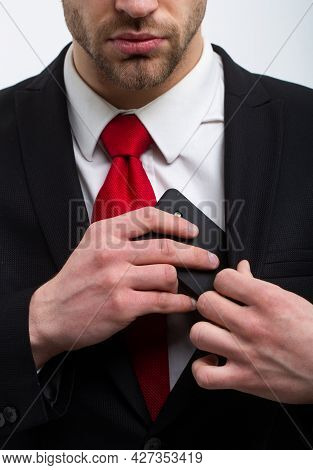 Young Businessman With Phone, Red Tie In A Suit And West, Business.