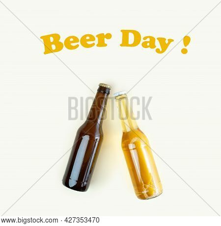 A Bottles Of Craft Beer On Beige Background. International Beer Day Or Octoberfest Concepts.text Bee