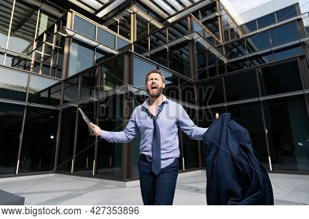 Confused Man Frustrated By Business Problem Shouting With Jacket And Laptop Outdoor, Frustration