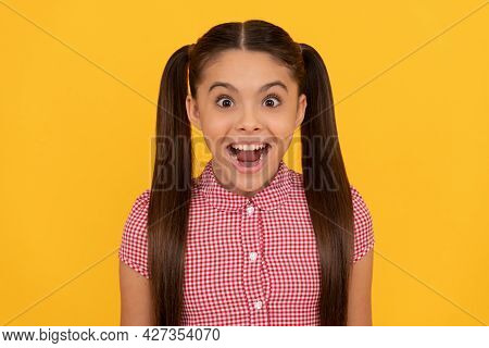 What A Pleasant Surprise. Girl Keep Mouth Open With Surprise. Surprised Kid Yellow Background