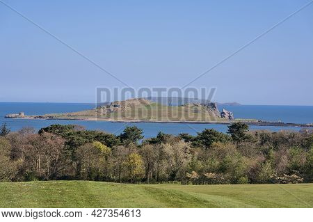 Beautiful Scenic Bright View Of The Ireland's Eye Island With Golf Course And Trees Seen From Howth,