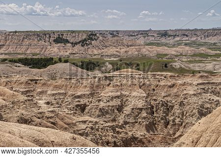 Badlands National Park, Sd, Usa - June 1, 2008: Closeup Of Canyon Wall Of Beige-brown Geological Dep