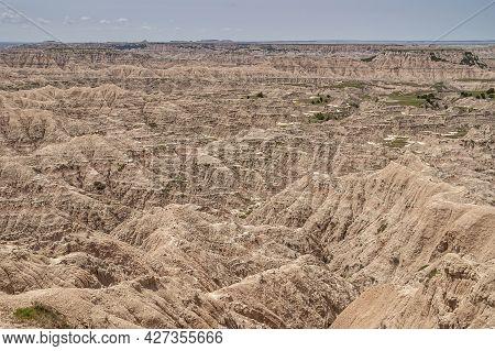 Badlands National Park, Sd, Usa - June 1, 2008: Nothing But Brown-beige Geological Deposits Forming