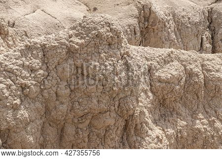 Badlands National Park, Sd, Usa - June 1, 2008: Closeup Of Dried Bubbly Beige Geological Deposit As