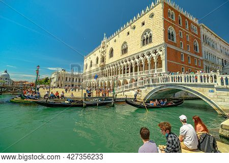 Venice, Italy - May 9, 2021: Traditional Gondolas For Touristic Cruise On Giudecca Canal By Saint Ma