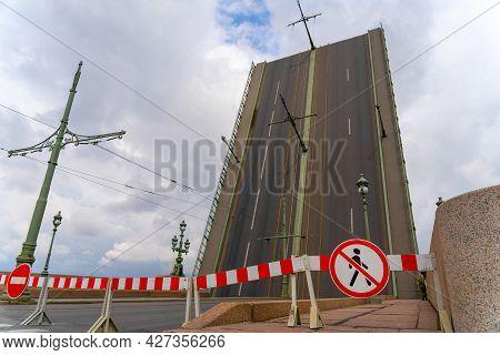 Raised Span Of Bascule Trinity Bridge Across The Neva In Saint Petersburg, Russia. Movable Bridge Is