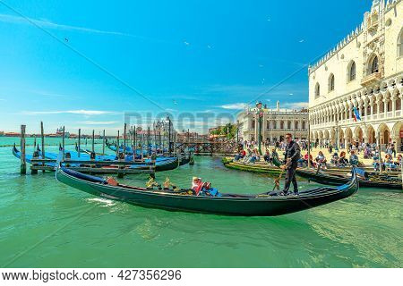 Venice, Italy - May 9, 2021: Traditional Gondola Boats Service With Tourists In Tour On Canal Grande